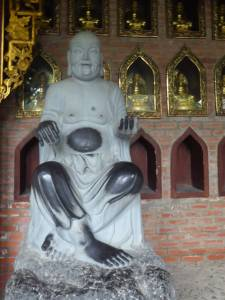 Buddha with black patches from people touching