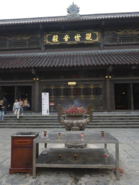 Incense burning in front of a temple