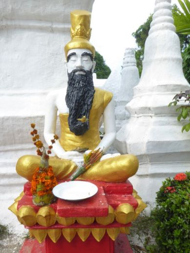 Statue with marigold offerings