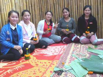 The girls with their flower stupas